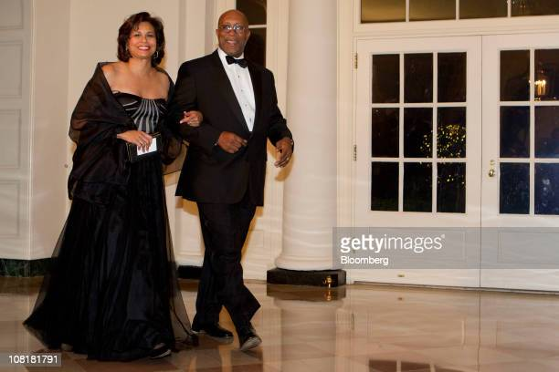 Ron Kirk US trade representative right and his wife Matrice EllisKirk arrive for a state dinner hosted by US President Barack Obama and first lady...