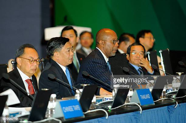 Ron Kirk US trade representative second right attends the AsiaPacific Economic Cooperation Finance Ministers' ministerial retreat in Singapore on...