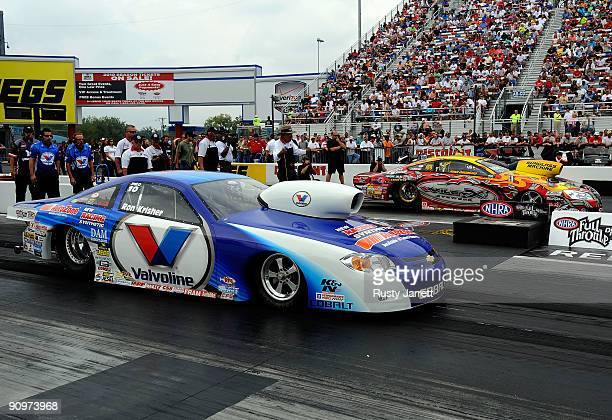 Ron Kirsher driver of the Valvoline pro stock Chevrolet lines up to race Ryan Ondrejko driver of the Wiley X GXP pro stock during qualifying for the...