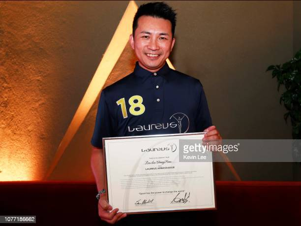 Ron Lee Chung Man poses with the certificate before the Laureus Hong Kong Ambassador Announcement ceremony at Mercedes Me Store on December 04 2018...