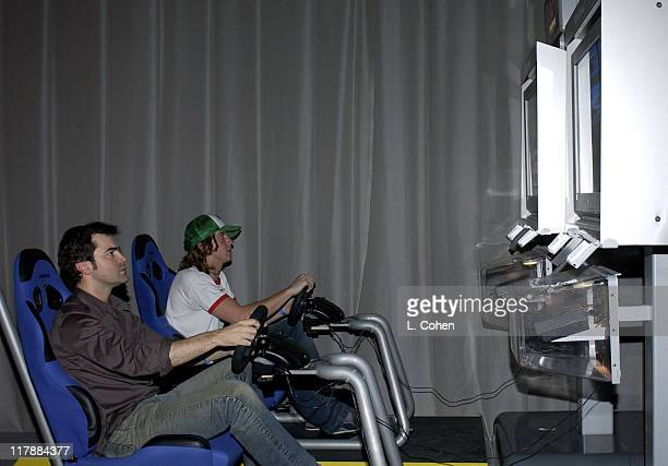 Ron Livingston driving Gran Turismo 4 during PlayStation 2 and Mark Wahlberg Host Celebrity Gaming Tournament for Charity Inside at Club Ivar in...