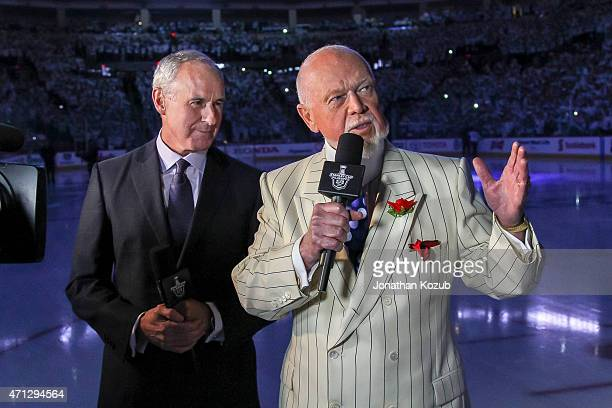 Ron MacLean and Don Cherry of Rogers Sportsnet stand on the ice prior to puck drop between the Winnipeg Jets and the Anaheim Ducks in Game Three of...