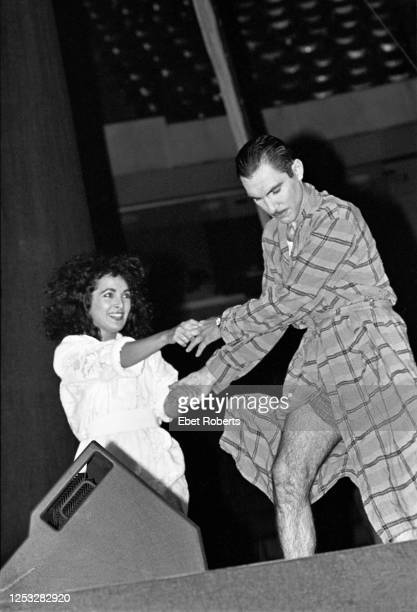 Ron Mael of Sparks and Jane Wiedlin of the Go-Go's performing at the Brendan Byrne Arena in East Rutherford, New Jersey on June 26, 1983.