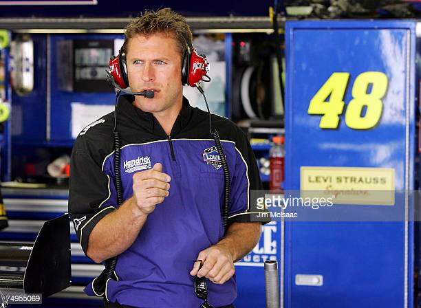 Ron Malec, crew chief of the Lowe's Chevrolet, driven by Jimmie Johnson, looks on in the garage, during practice for the NASCAR Nextel Cup Series...