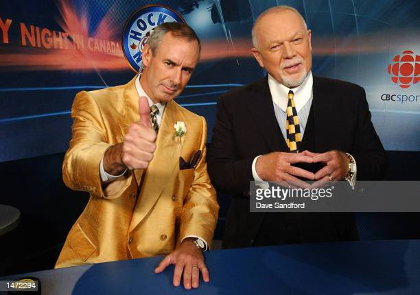 Ron McLean gives the thumbs up as he and Don Cherry prepare for their first game of the season on Hockey Night in Canada between Ottawa and Toronto...