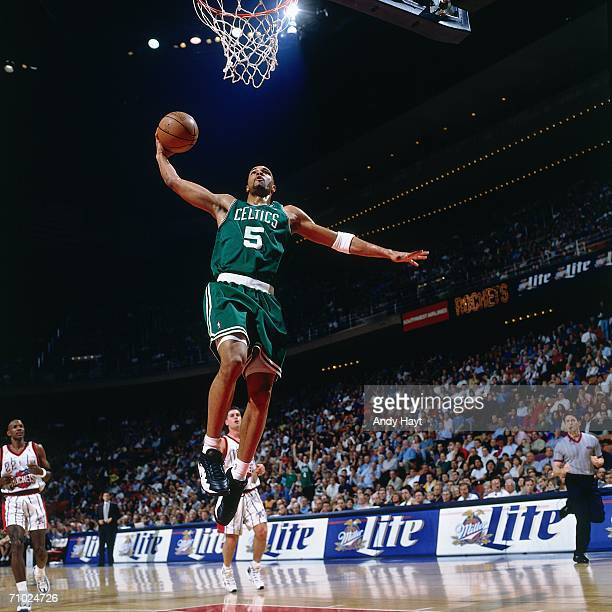 Ron Mercer of the Boston Celtics elevates for the dunk during a game against the Houston Rockets at the Summit on March 19 1998 in Houston Texas NOTE...