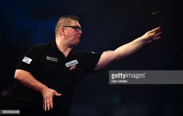 Ron Meulenkamp of the Netherlands throws during his first round match against Mensur Suljovic of Serbia on day seven of the 2017 William Hill PDC...
