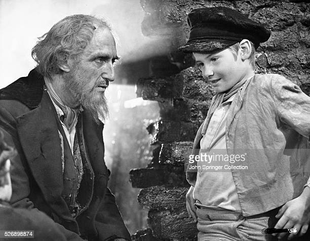 Ron Moody as Fagin and Mark Lester as Oliver Twist in the 1968 musical Oliver