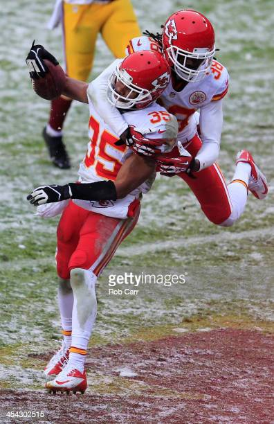 Ron Parker jumps on the back of kick returner Quintin Demps of the Kansas City Chiefs after Demps returned a kickoff for a touchdown during the...