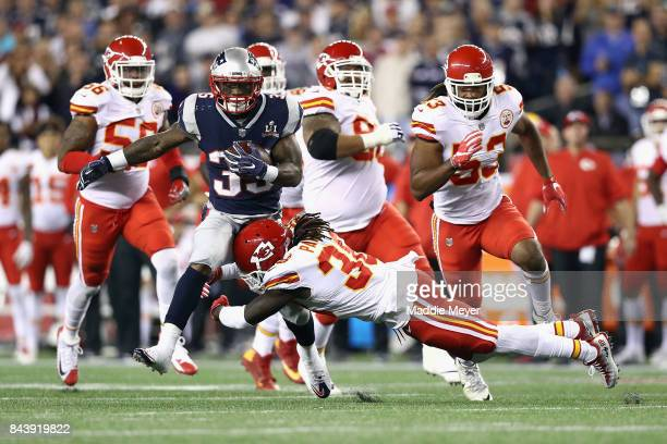 Ron Parker of the Kansas City Chiefs attempts to tackle Mike Gillislee of the New England Patriots during the first half of their game at Gillette...