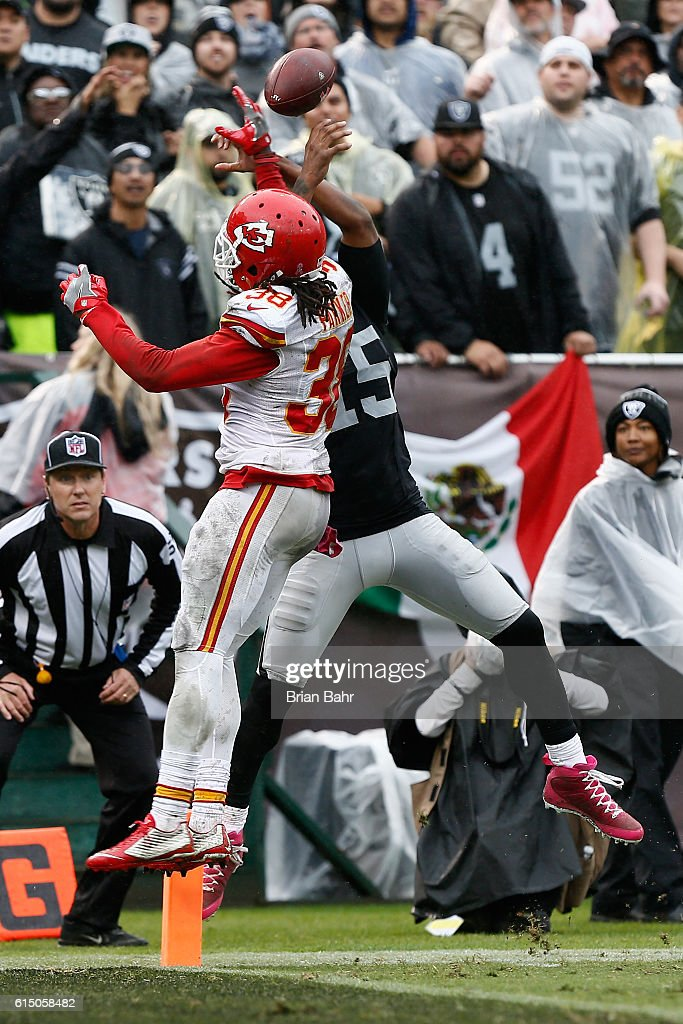 Ron Parker #38 of the Kansas City Chiefs breaks up a pass intended for Michael Crabtree #15 of the Oakland Raiders during their NFL game at Oakland-Alameda County Coliseum on October 16, 2016 in Oakland, California.
