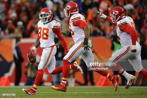 Ron Parker of the Kansas City Chiefs celebrates his interception of a pass by Peyton Manning of the Denver Broncos with Derrick Johnson and Tamba...