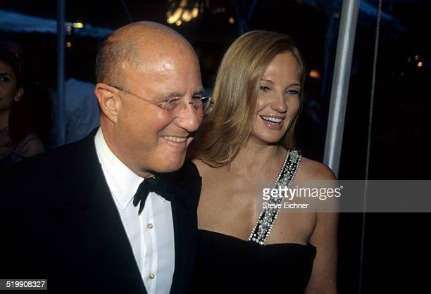 Ron Perelman and Ellen Barkin at event, New York, 1990s.