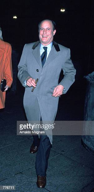 Ron Perelman smiles as he walks down the street November 16 1997