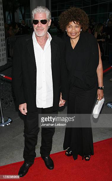 Ron Perlman and Opal Perlman attend the FX Network's Sons Of Anarchy Season 4 Premiere on August 30 2011 in Hollywood California