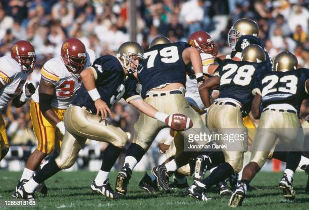 Ron Powlus, Quarterback for the Notre Dame Fighting Irish hands off the football to Running Back Ken Barry during the NCAA Pac - 10 Conference...