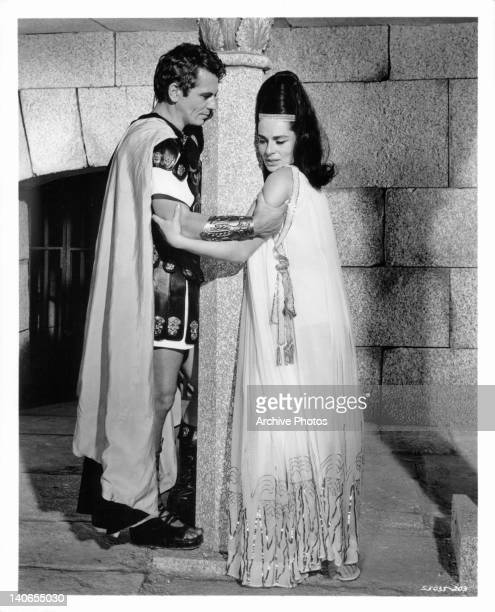 Ron Randell holding onto Viveca Lindfors in a scene from the film 'King Of Kings' 1961