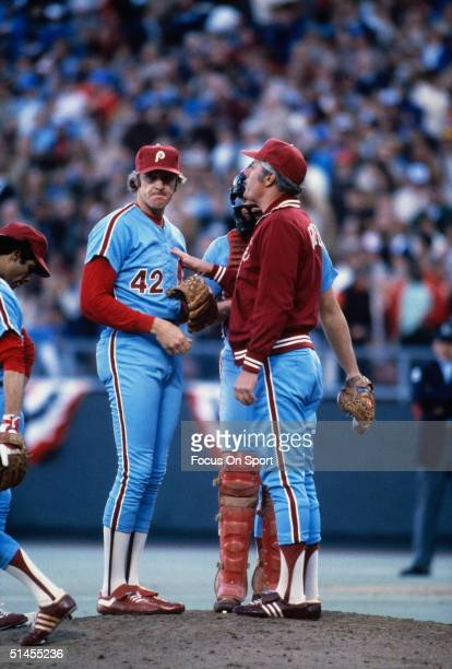 Ron Reed of the Philladelphia Phillies talks to his manager Dallas Green on the mound during the World Series against the Kansas City Royals at...