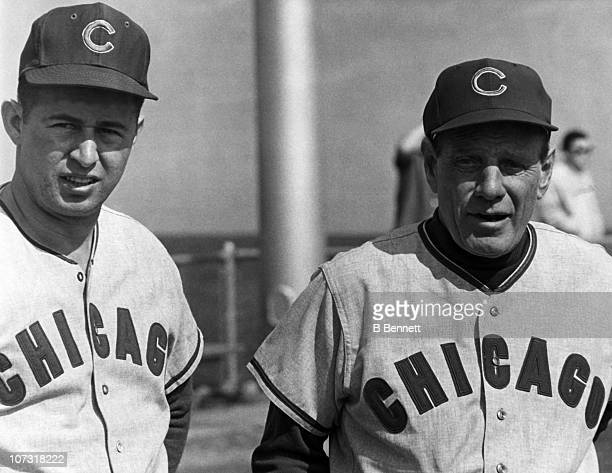 Ron Santo and manager Leo Durocher of the Chicago Cubs look on during the first spring training workout in February 1966 in Long Beach California