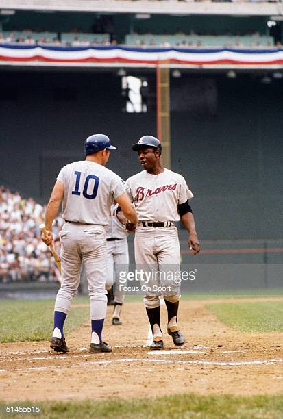 Ron Santo of the Chicago Cubs congratulates Hank Aaron of the Atlanta Braves during the AllStar Game at RFK Stadium on July 23 1969 in Washington DC