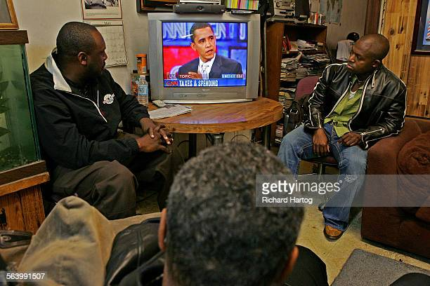 Ron Simmons left and Kevin Holks watch the democratic debate on television at Tolliver's barber shop in Los Angeles Thursday January 31 2008