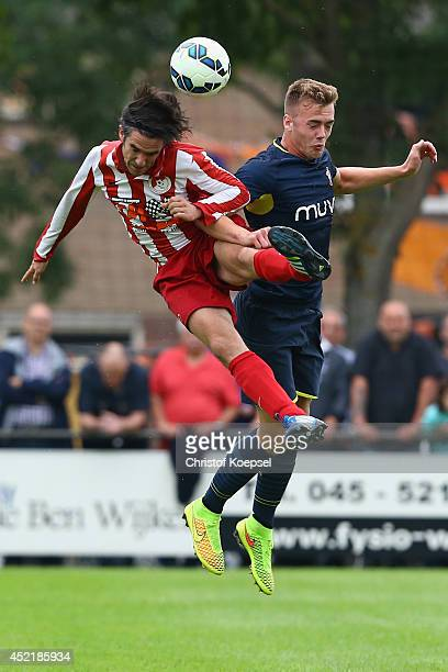 Ron Starmans of Hoensbroeck and Calum Chambers of Southampton go up for a header during the pre season friendly match between EHC Hoensbroek and...
