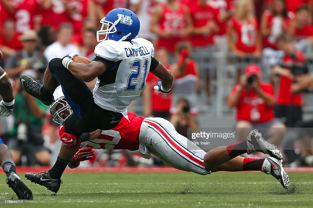 Ron Tanner #20 of the Ohio State Buckeyes tackles Devin Campbell #21 of the Buffalo Bulls during the third quarter on August 31, 2013 at Ohio Stadium in Columbus, Ohio. Ohio State defeated Buffalo 40-20.