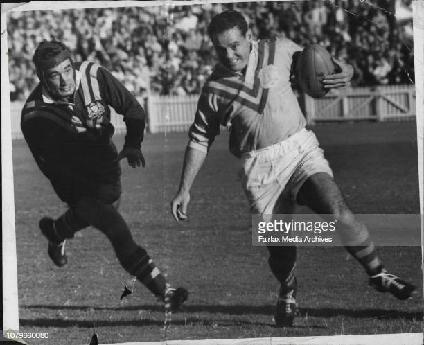 Ron Taylor Sydney centre making a swerving run in the City v Country match at the SCG last Saturday May 17 1958