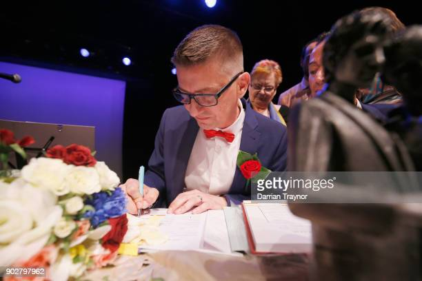 Ron Van Houwelingen signs his marriage certificate with Antony McManus on January 9 2018 in the theatre where they met 30 years ago in Melbourne...