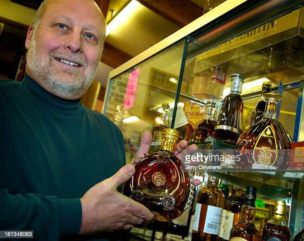 DENVER COLO FEBRUARY 17 2005 Ron Vaughn <cq> owner of Argonaut Liquors <cq> holds a bottle of Remy Martin Louis XIII Grande Champagne Cognac <cq> in...