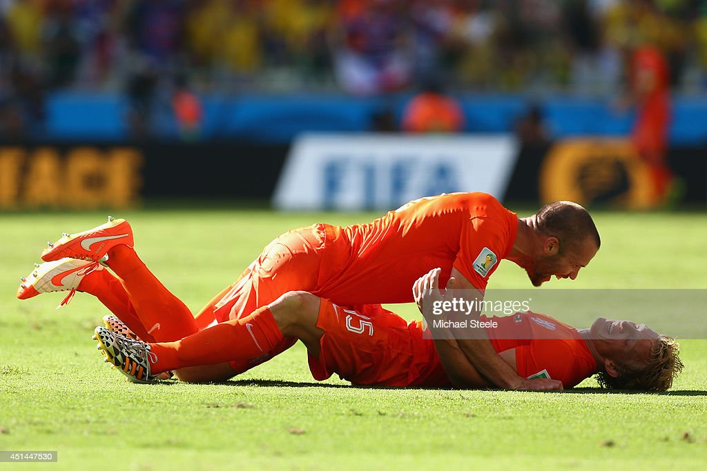 Ron Vlaar and Dirk Kuyt of the Netherlands celebrate defeating Mexico 2-1 in the 2014 FIFA World Cup Brazil round of 16 match between Netherlands and Holland at Arena Castelao on June 29, 2014 in Fortaleza, Brazil.