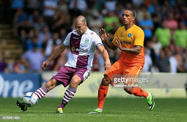 Ron Vlaar of Aston Villa and Dean Morgan of Wycombe Wanderers