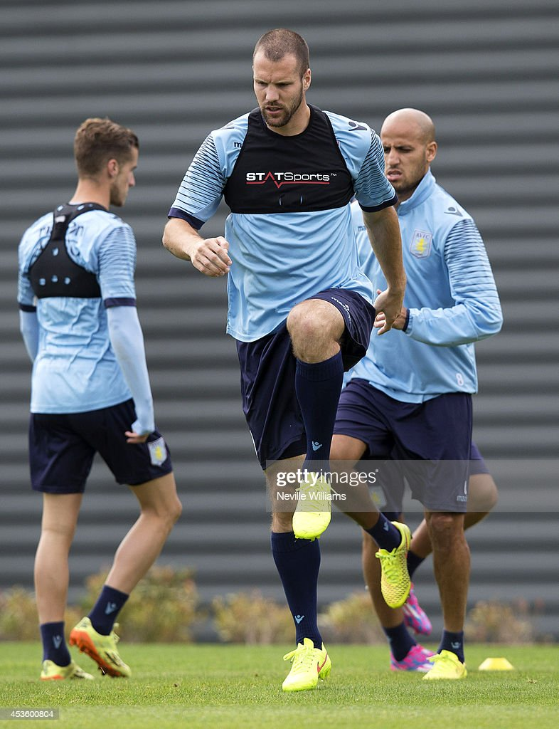 Ron Vlaar of Aston Villa in action during an Aston Villa training session at the club's training ground at Bodymoor Heath on August 14, 2014 in Birmingham, England.