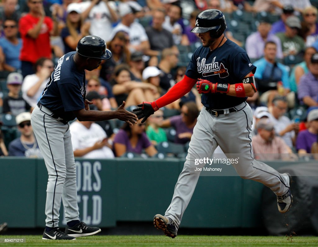 Ron Washington #37 of the Atlanta Braves slaps hands with Tyler Flowers #25 of the Atlanta Braves as Flowers rounds third base after hitting a home run against the Colorado Rockies in the second inning at Coors Field on August 17, 2017 in Denver, Colorado. Atlanta won 10-4.