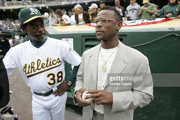 Ron Washington of the Oakland Athletics talks with Rickey Henderson before game three of the American League Division Series against the Minnesota...