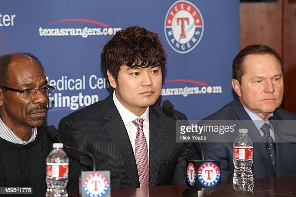 Ron Washington, Shin-Soo Choo and Scott Boras during the press conference introducing Choo at Rangers Ballpark in Arlington on December 27, 2013 in...