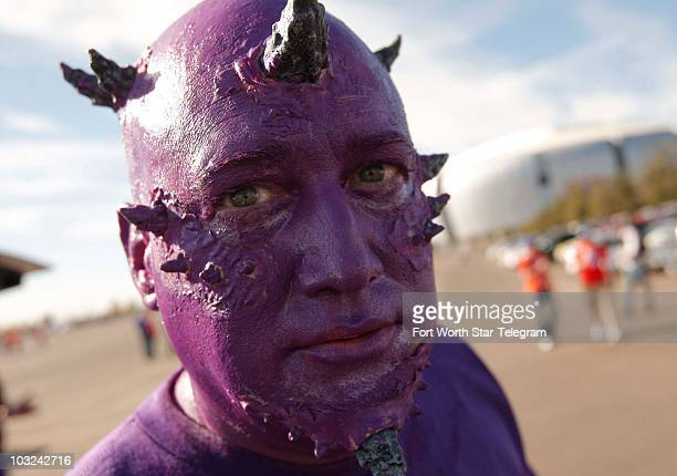 Ron White of Bedford Texas dressed as a Horned Frog as Texas Christian faced Boise State in the Tostitos Fiesta Bowl in Glendale Arizona on Monday...