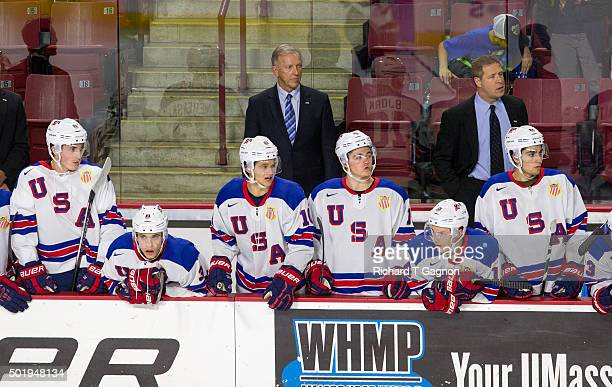 Ron Wilson head coach of the USA National Junior Team stands behind the bench during NCAA hockey action against the Massachusetts Minutemen at the...