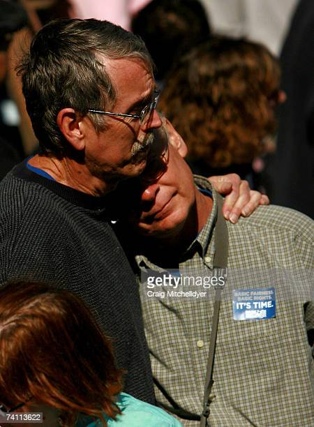 Ron Wold and Ken Hindes of Eugene Oregon partners for 30 years embrace after Oregon Governor Ted Kulongoski signed two bills protecting gay rights...