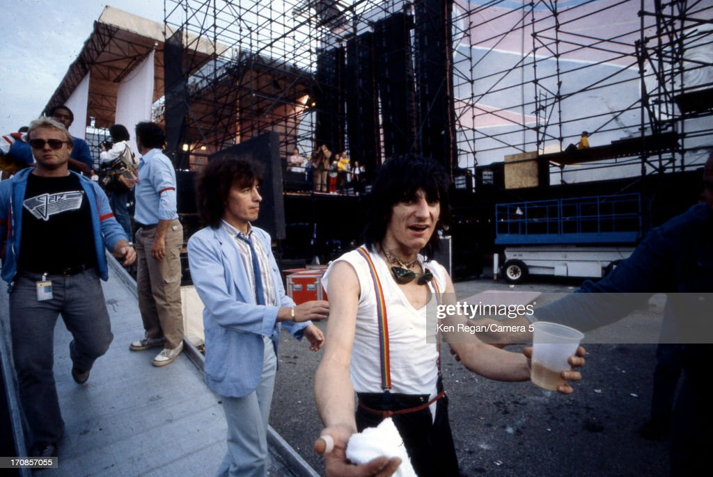 Ron Wood and Bill Wyman of the Rolling Stones are photographed on June 25-26, 1982 backstage at Wimbley Stadium in London, England.