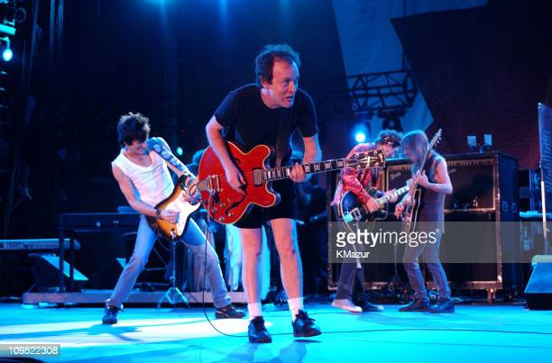 Ron Wood and Keith Richards of The Rolling Stones with Angus and Malcolm Young of AC/DC