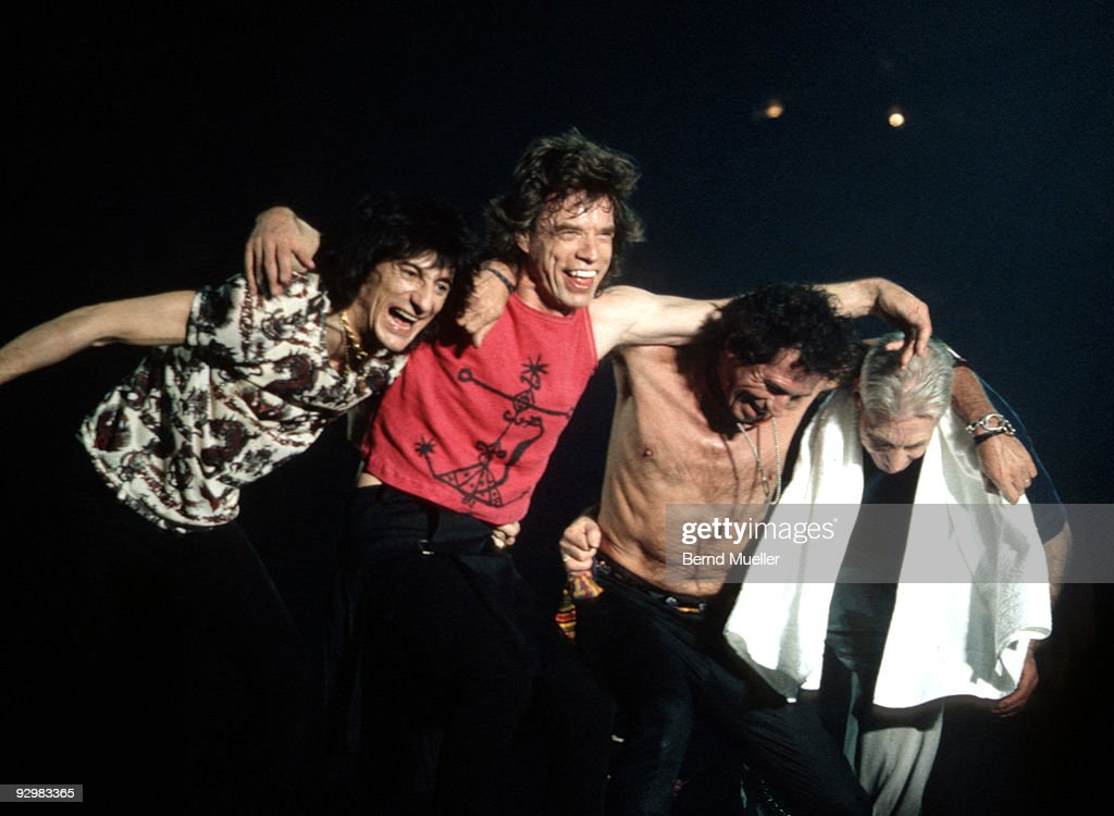 Ron Wood, Mick Jagger, Keith Richards and Charlie Watts stand together with their arms around each other at the front of the stage on their Bridges To Babylon tour at Wembley Stadium on June 11th 1999 in London.