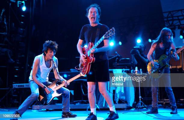 Ron Wood of The Rolling Stones with Angus Young and Malcolm Young of AC/DC