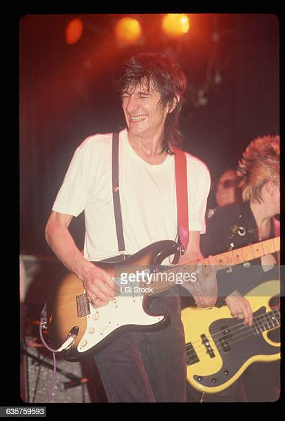 Ron Wood plays the guitar during a Rolling Stones concert
