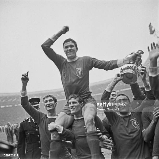 Ron Yeats, captain of Liverpool FC, is carried by his teammates after they won the 1965 FA Cup final at Wembley Stadium in London, UK, 1st May 1965....