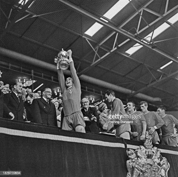 Ron Yeats, captain of Liverpool FC, is followed by his teammates after winning the 1965 FA Cup final at Wembley Stadium in London, UK, 1st May 1965....