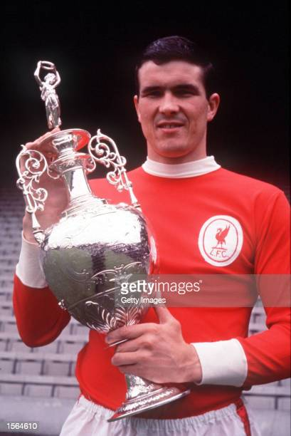Ron Yeats of Liverpool holds up the 1965/66 League Championship Trophy Mandatory Credit Allsport UK