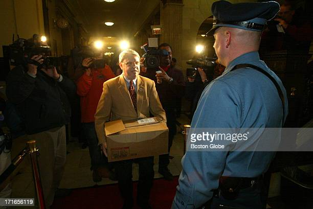 Ronald A Crews President of the Massachusetts Family Institute delivers a box of some of the 16000 petitions to Trooper Robert Pitts outside the...