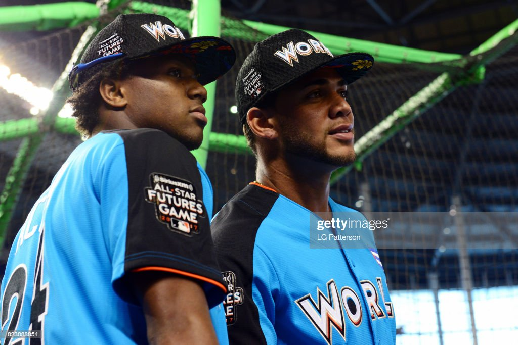 Ronald Acuña #24 and Yoan Moncada #10 of the World Team look on during batting practice prior to the SirusXM All-Star Futures Game at Marlins Park on Sunday, July 9, 2017 in Miami, Florida.
