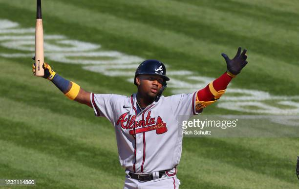 Ronald Acuña Jr. #13 of the Atlanta Braves reacts after being called out on strikes during the ninth inning of a baseball game against the...